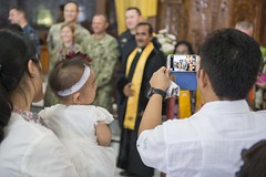 Local residents take photos with service members from New Zealand and the United States following a religious service at the Ebenezer Oeba Church in Kupang, Indonesia. (U.S. Navy/MC1 Stephen Oleksiak)