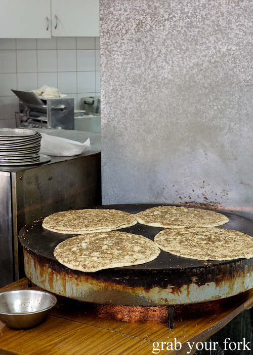 Saj breads cooking on the saj griddle at Charlie's Pizza, Canterbury