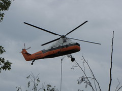 Helicopter delivering a rooftop HVAC unit