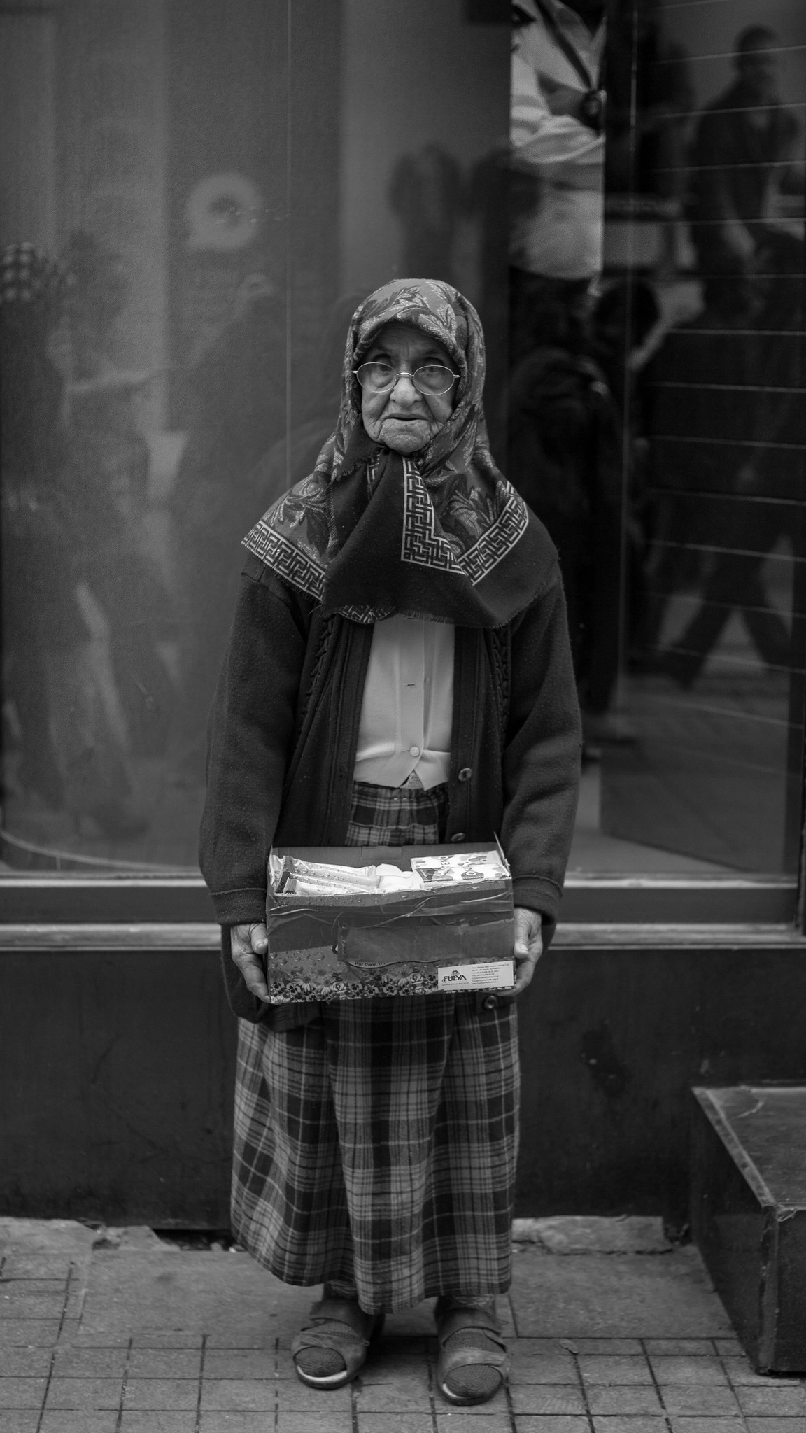 Old woman selling tissues on Istiklal Street.