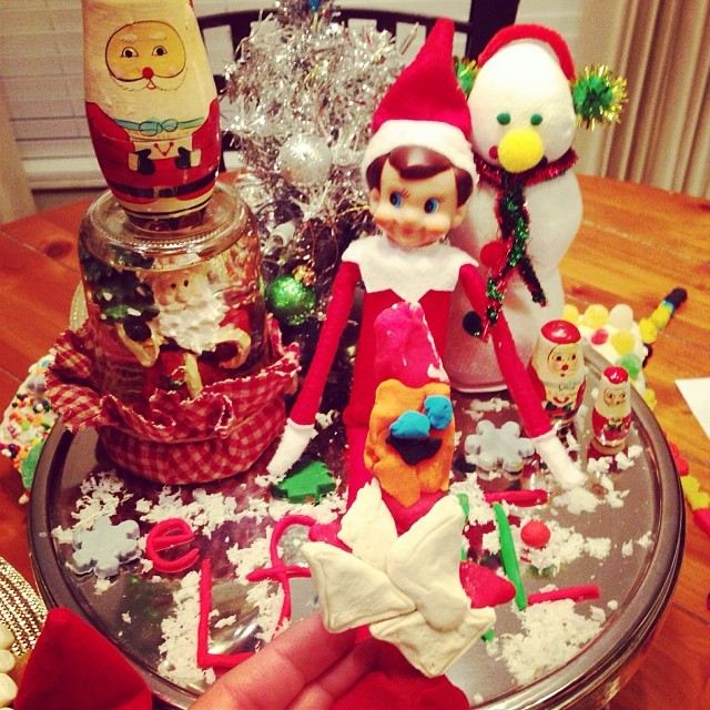 The elves are bringing play dough with Christmas cutters I, gingerbread cookie dough and a hot Nutella cocoa bar in the crock pot tomorrow, so we have lots to do while we are snowed, err... Iced in all day! Look at what I am holding up, this is the elf Au