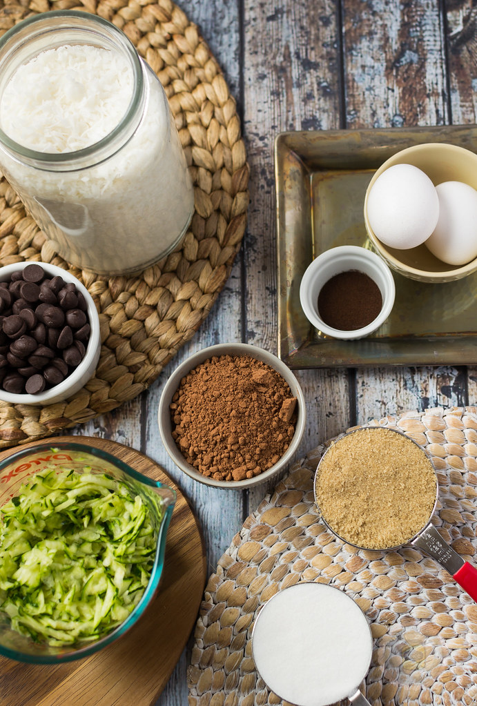 Ingredients ready to use: Cocoa powder, eggs, brown sugar, cut up zucchini, chocolate chips, coconut flakes and salt