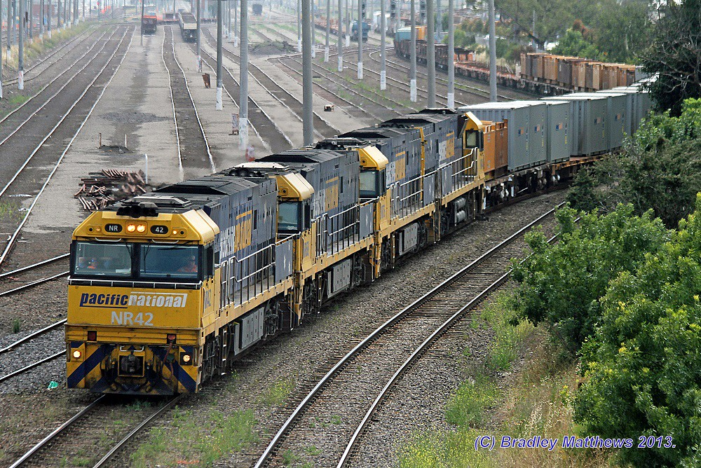 NR42-NR68-NR76-NR44 with 3PW4 steel goods to Melbourne, later to Port Kembla at West Footscray (20/12/2013) by Bradley Matthews