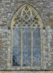 The south transept south window with 14th C Decorated Gothic tracery, the Church of St Candida and Holy Cross, Whitchurch Canonicorum, Dorset, England