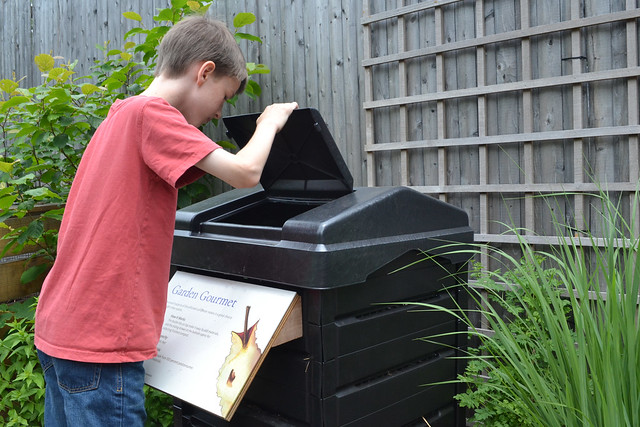 A visitor explores BBG's Home Composting exhibit. Photo by Blanca Begert.
