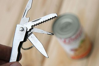 Open can with swiss army knife