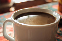 food(0.0), hot chocolate(0.0), caff㨠macchiato(0.0), dessert(0.0), chocolate(0.0), espresso(1.0), cup(1.0), cup(1.0), coffee milk(1.0), caf㩠au lait(1.0), coffee(1.0), coffee cup(1.0), caff㨠americano(1.0), drink(1.0), caffeine(1.0),