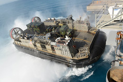 A Landing Craft Air Cushion (LCAC) transfers Marine Corps equipment and personnel aboard USS Bonhomme Richard (LHD 6), Feb. 24. (U.S. Navy/MC2 Michael Achterling)