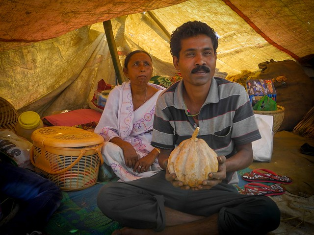 "Mangaljyoti Bhuyan from Morigaon who has been coming to the Jon beel mela for the last 12 years exchanged pitha, jalpan and fish with the ginger, turmeric and gourds from the tribes of the hills. He says, ""It is not profitable, rather expensive for us to give fish for vegetables. But we still do it as the festival brings all of us together. My forefathers also came and my children will also come""."