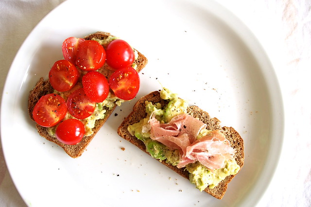 avocado toast with cherry tomatoes and prosciutto