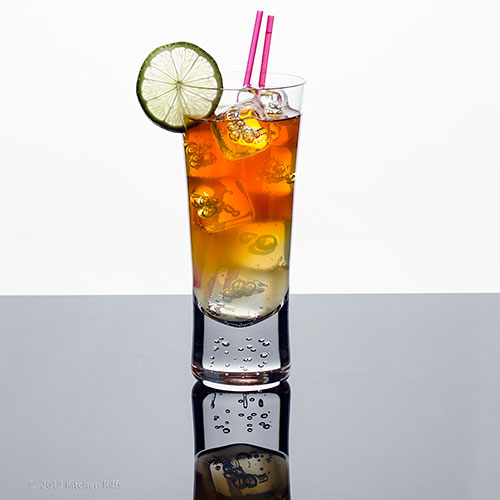 Dark and Stormy Cocktail in tall glass with lime garnish