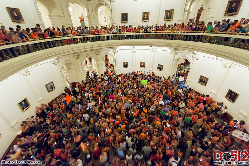 thousands of texans in orange shirts protesting abortion restrictions