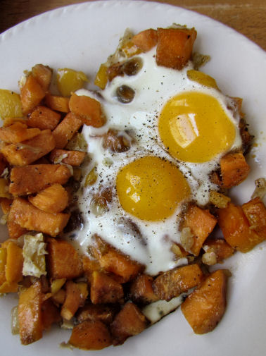 Eggs over sweet potato hash