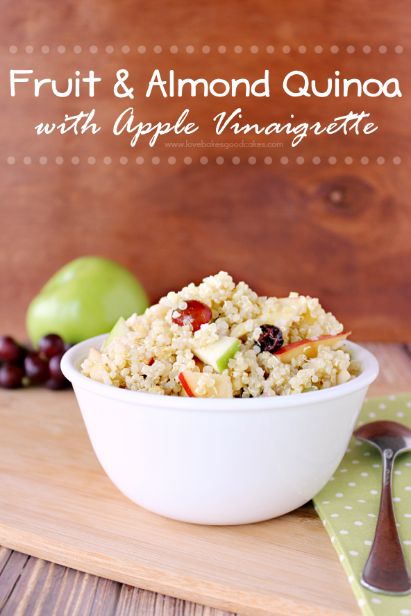 Fruit and Almond Quinoa with Apple Vinaigrette in a white bowl with a spoon.