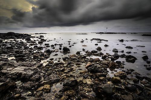 seascape oceanrocksbandstandarabianseaskycloudssunsetlong oceanrocksbandstandarabianseaskycloudssunsetlongexposurerainclouds