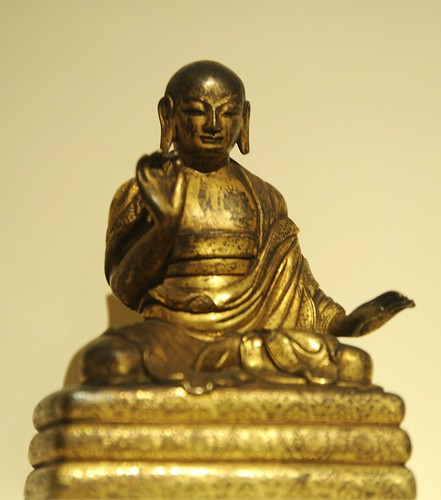 Bodhisattva monk, seated on cushions, gilt copper alloy, China, Tang dynasty (618-907) c.8th Century, Chicago Art Institute, Illinois, USA by Wonderlane