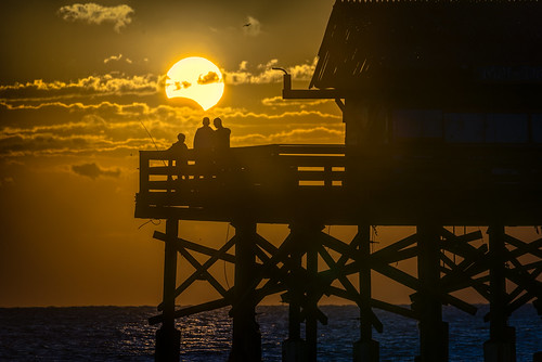 ocean sky people orange usa cloud moon water weather sunrise landscape dawn eclipse pier fishing dock florida candid existinglight astronomy cocoa partial solareclipse centralflorida peoplephotography