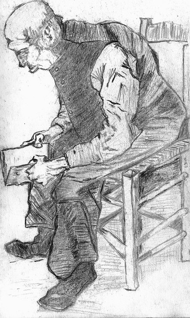 Old man in a chair reading