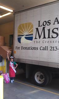 8-27-13 CA JP Valerie Estrada donating toys