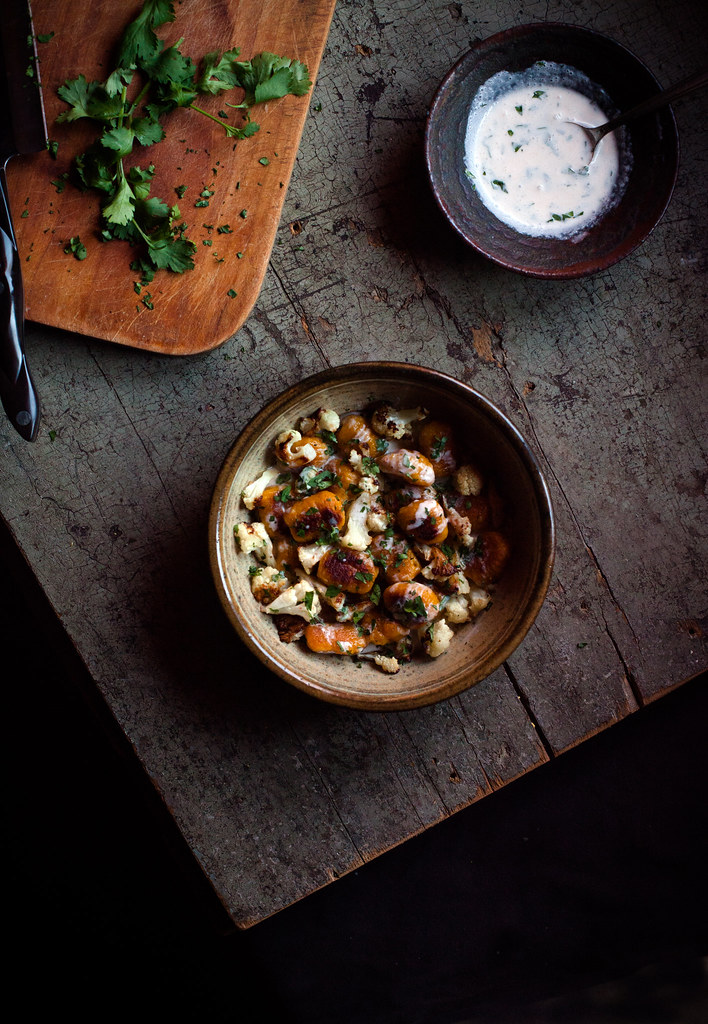 Curry-Spiced Kabocha Gnocchi with Roasted Cauliflower & Sriracha-Coconut Crème Fraîche