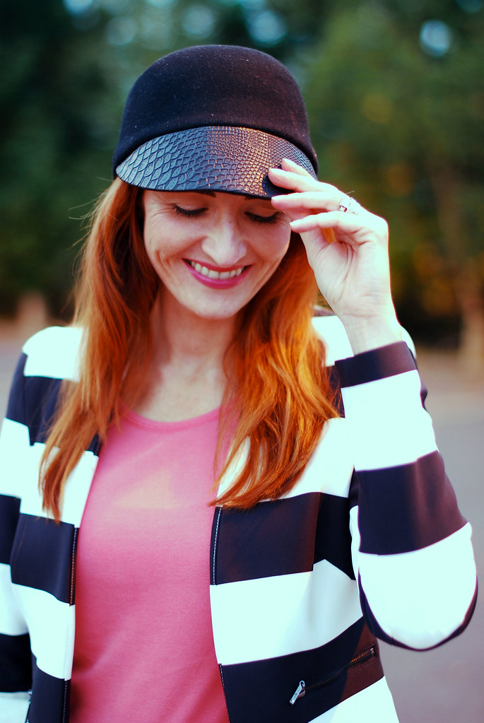 Black peak cap, black & white striped jacket