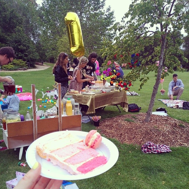 At Clover's 1st birthday party, eating pink cake & macaroons @elle20121