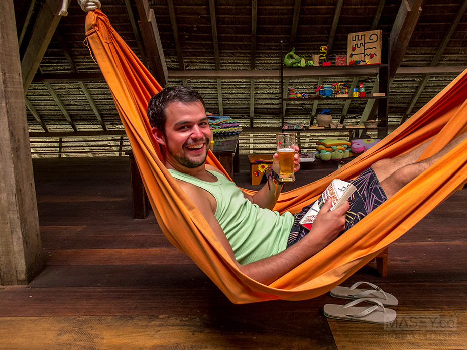 Rob dives into a neighbouring hammock, and an amber beverage.