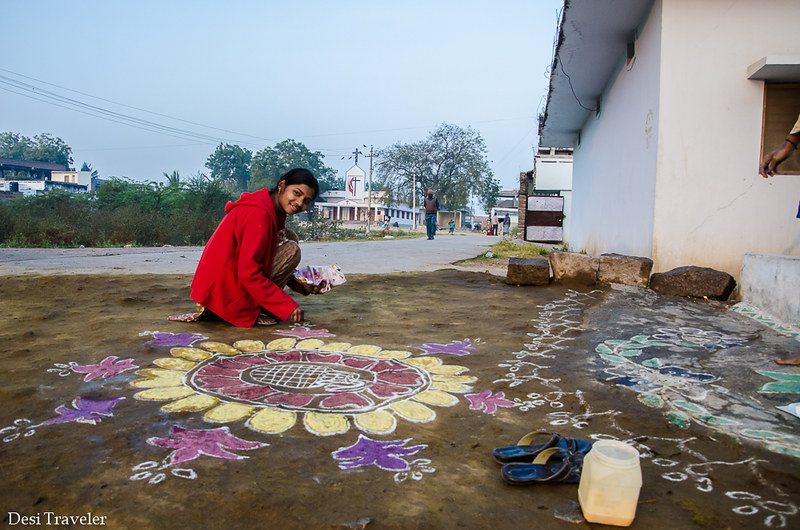 girl making rangoli in Telangana Village India