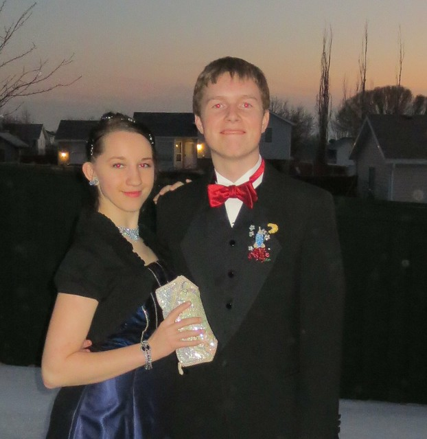 oldest with her date wearing boutonnière