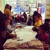 Kids signing up for today's Easter Egg Hunt at My Gym in Harlem.
