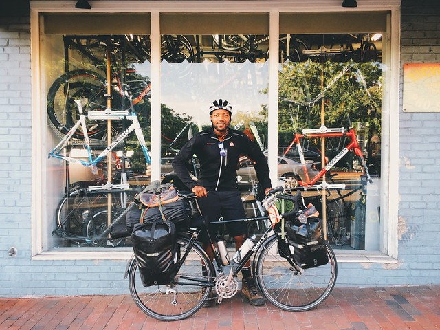 Cool meeting @dwayne_burgess today #intheshop. He's riding across the country just to do it. I'd be jealous of this adventure if it wasn't for how LOADED his Surly LHT was. // #vscocam #bikedc #makeportraits