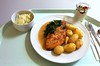 Salmon filet with leaf spinach in tarragon sauce with rosemary potatoes / Lachsfilet mit Blattspinat in Estragonsauce mit Rosmarinkartoffeln