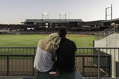 Couple Watch Barons Baseball from the Outfield