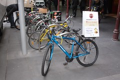Another bicycle parked on Swanston Street, positioned for advertising purposes