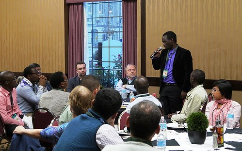 James Mlamba, a Borlaug Fellow from Malawi currently studying at the University of Missouri, introduces himself to other fellows gathered for the Borlaug Symposium orientation dinner at the 2013 World Food Prize. Approximately 40 Borlaug Fellows and their mentors attended the annual event in Des Moines to network, meet members of the Borlaug family and high-level agricultural officials and this year's World Food Prize Laureates. (Photo by Jared Henderson, University of Missouri)