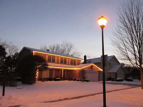 Outdoor Christmas holiday lights turned on at twilight.  Palatine Illinois.  December 2013. by Eddie from Chicago