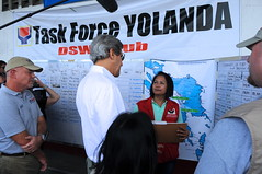 Secretary Kerry Receives a Typhoon Haiyan Recovery Briefing at the Welfare Distribution Center in Tacloban City