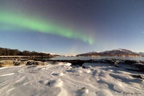 Jan 20. 2014 Stamnes, Sortland in Norway. Around –10 degree C cold. Aurora over iced rocks.