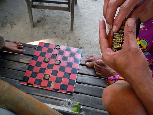 In Mandalay, a game with bottle caps