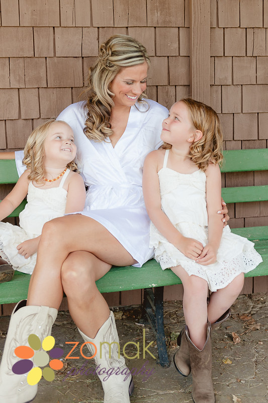 Beautiful smiles between the bride and her flower girls before the ranch wedding in washington