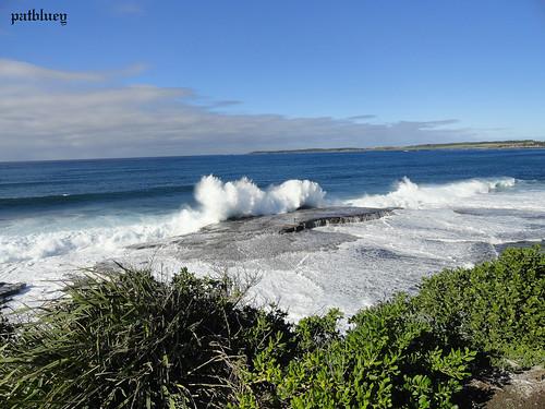Waves crashing onto rocks at Barrack Point.