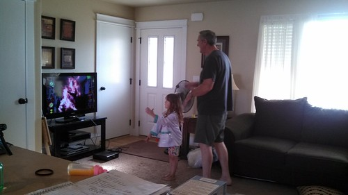 Lily and her grandpa playing Kinect party