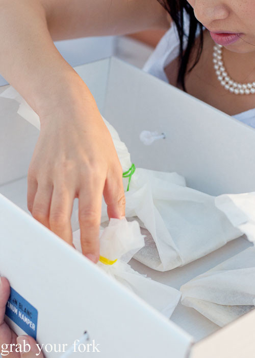 Unpacking our picnic boxes at Diner en Blanc Sydney 2013 Bondi Beach