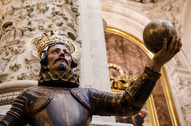 A statue of Christopher Columbus at the massive Cathedral of Seville.