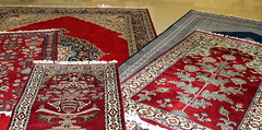 art(0.0), tablecloth(0.0), tapestry(1.0), pattern(1.0), textile(1.0), red(1.0), maroon(1.0), prayer rug(1.0), design(1.0), carpet(1.0), flooring(1.0),
