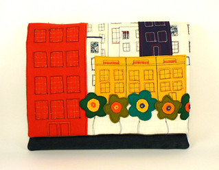 "Upcycled denim, cotton, linen and felt embroidered iPad clutch - ""red, yellow and green houses and flowers""+"