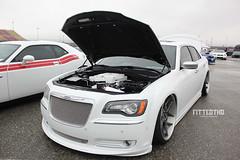 auto show(0.0), automobile(1.0), automotive exterior(1.0), wheel(1.0), vehicle(1.0), automotive design(1.0), rim(1.0), chrysler 300(1.0), chrysler(1.0), bumper(1.0), sedan(1.0), land vehicle(1.0), luxury vehicle(1.0),