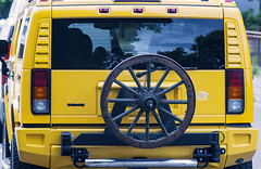 Hummer with a wagon wheel