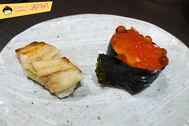 Sushi Bar YASUDA in Tokyo - part of 12 pieces sushi assortment - sea eel and salmon roe