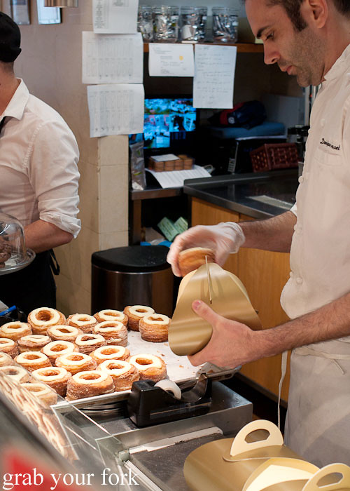 packing cronuts into carry boxes at dominique ansel bakery nyc new york